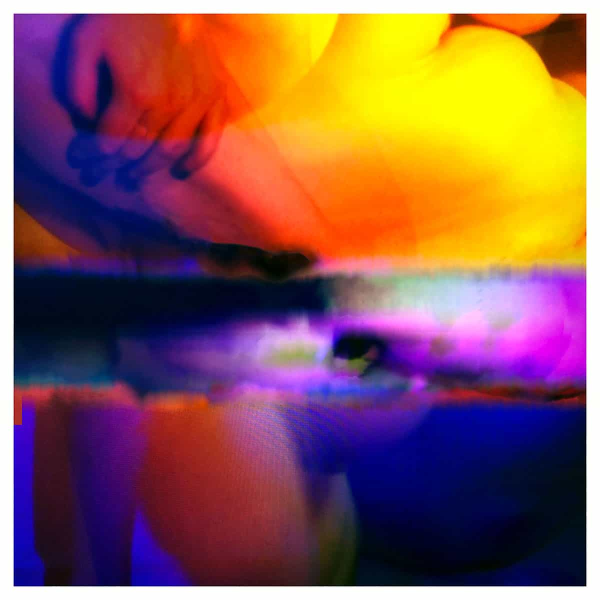colorful abstract photograph with fragments of human body including a hand -in reds, and purples and blues and yellows