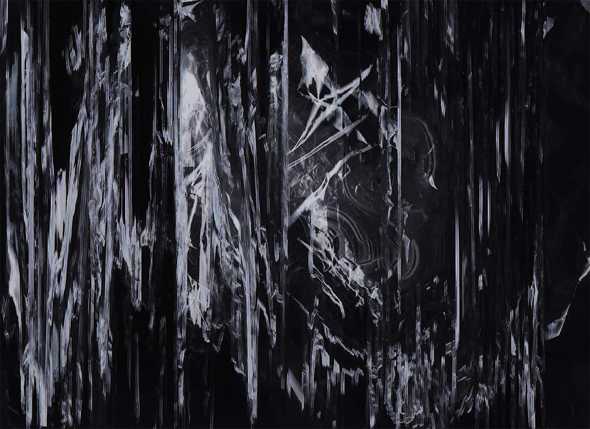 abstract black photograph with gray vertical streaking lines