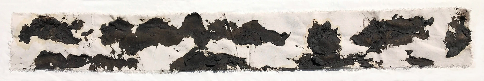 piece of canvas with black marks made with asphalt.