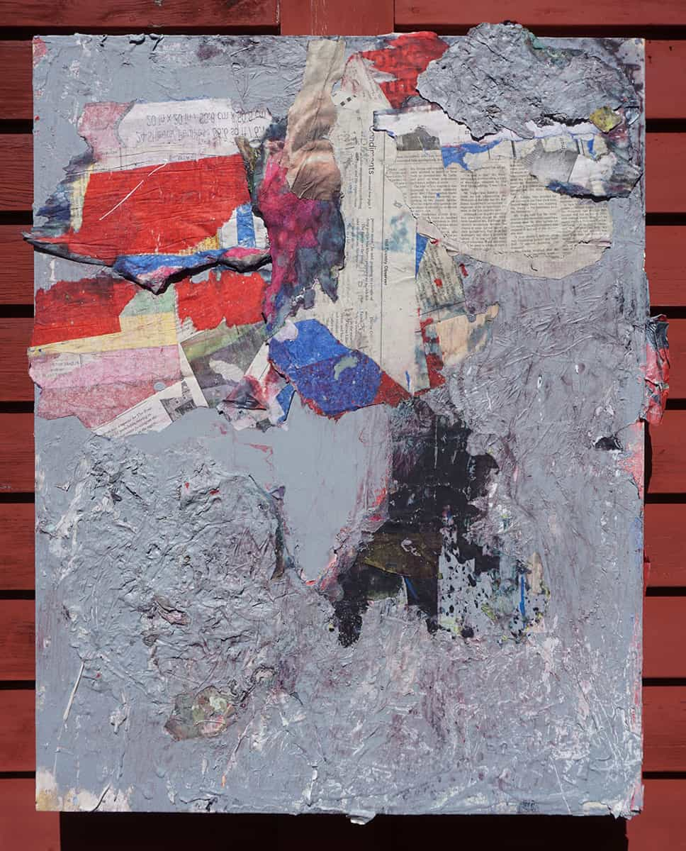 collage with paint, mostly grey, including pieces of newspaper