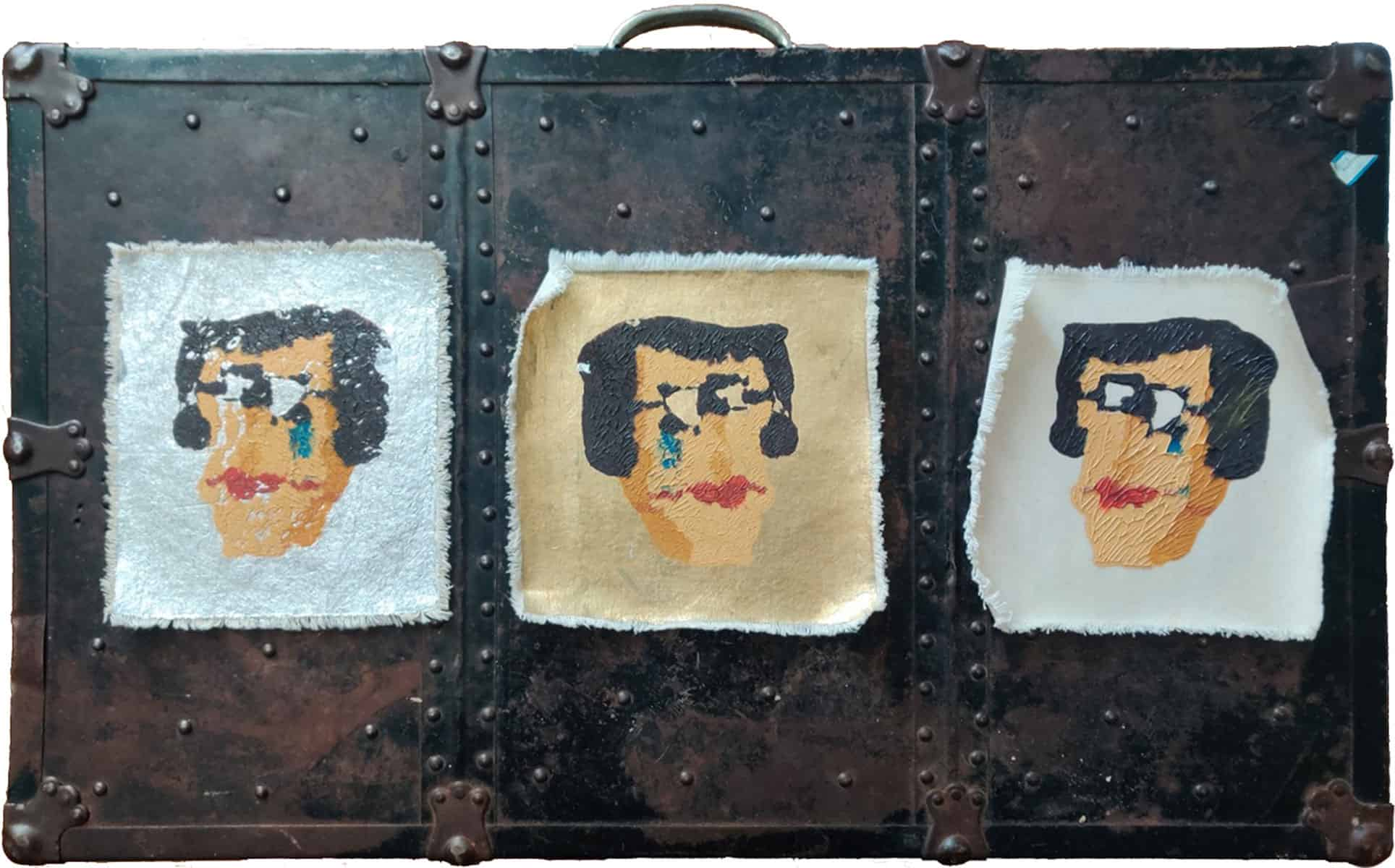brown suitcase with 3 pieces of canvas, each with a portrait