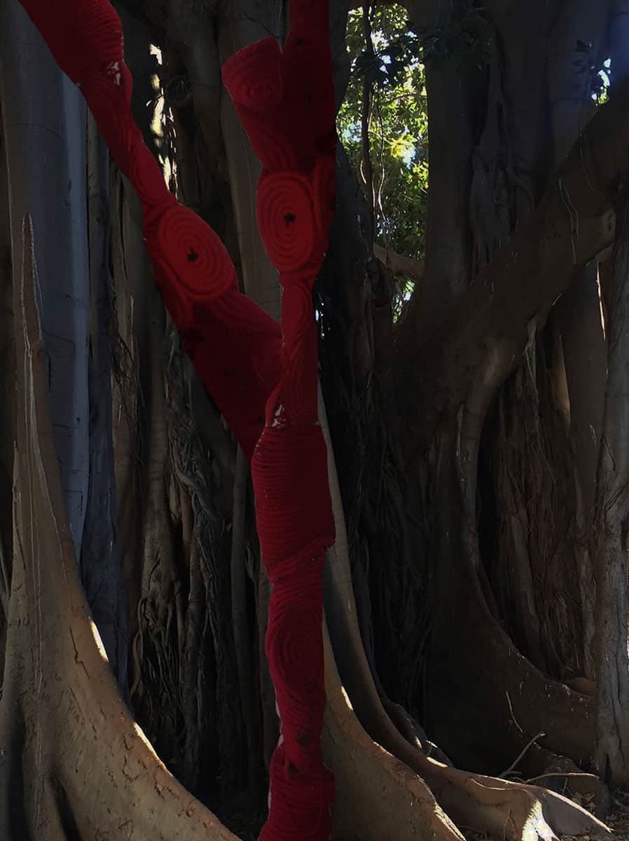 digital collage of trees and red abstract sculpture
