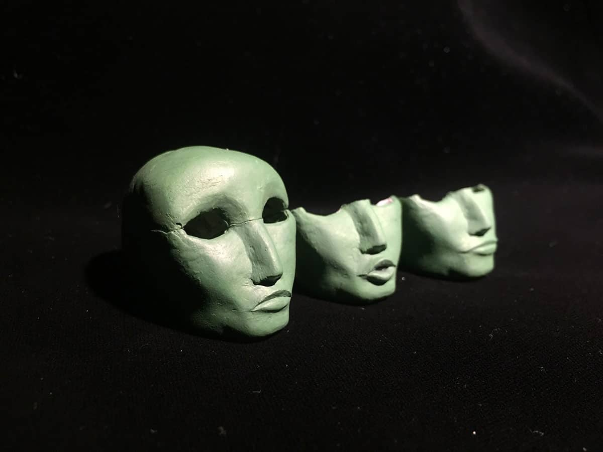 photograph of blank puppet faces on a black background