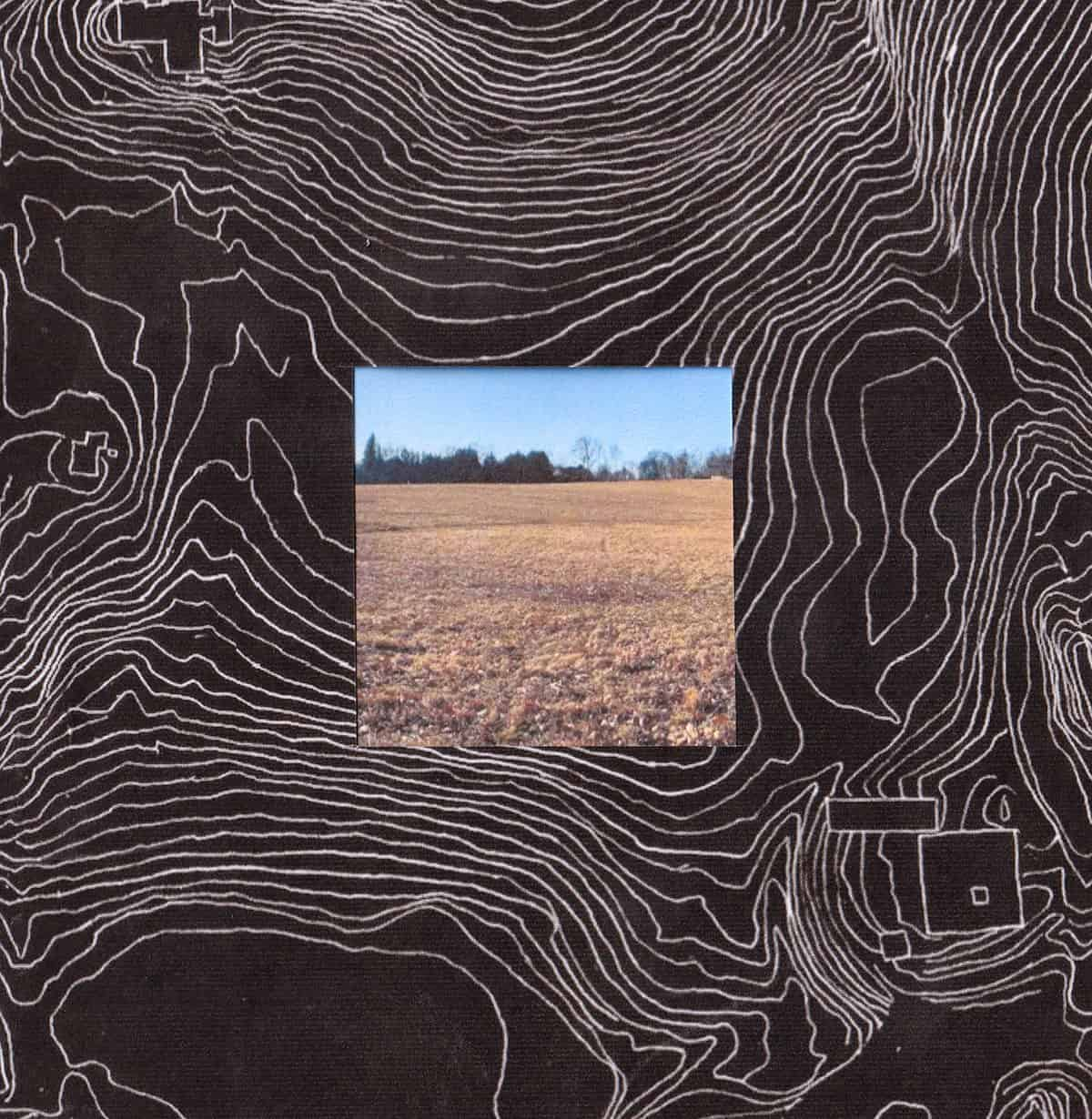 photograph of field placed in the middle of a topographical drawing in white chalk on black paper