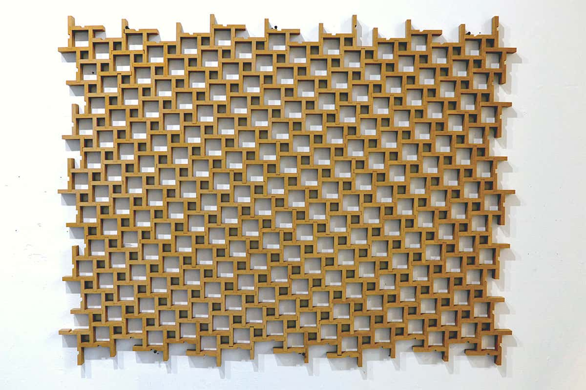 wall sculpture of repeating geometric pattern