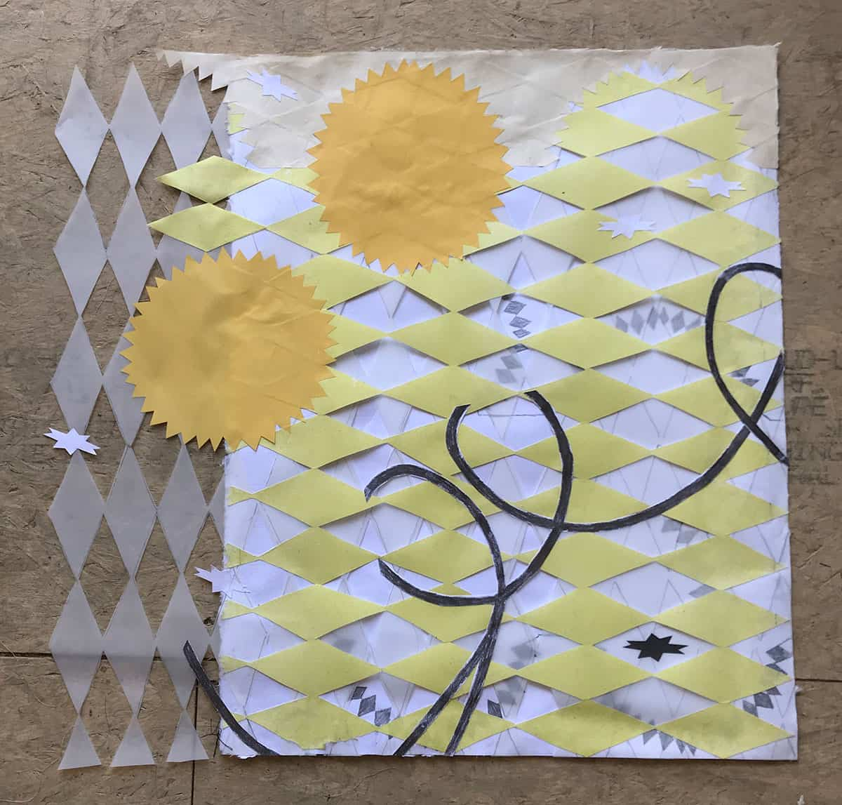 yellow and white print with looping line, stars, and diamond pattern